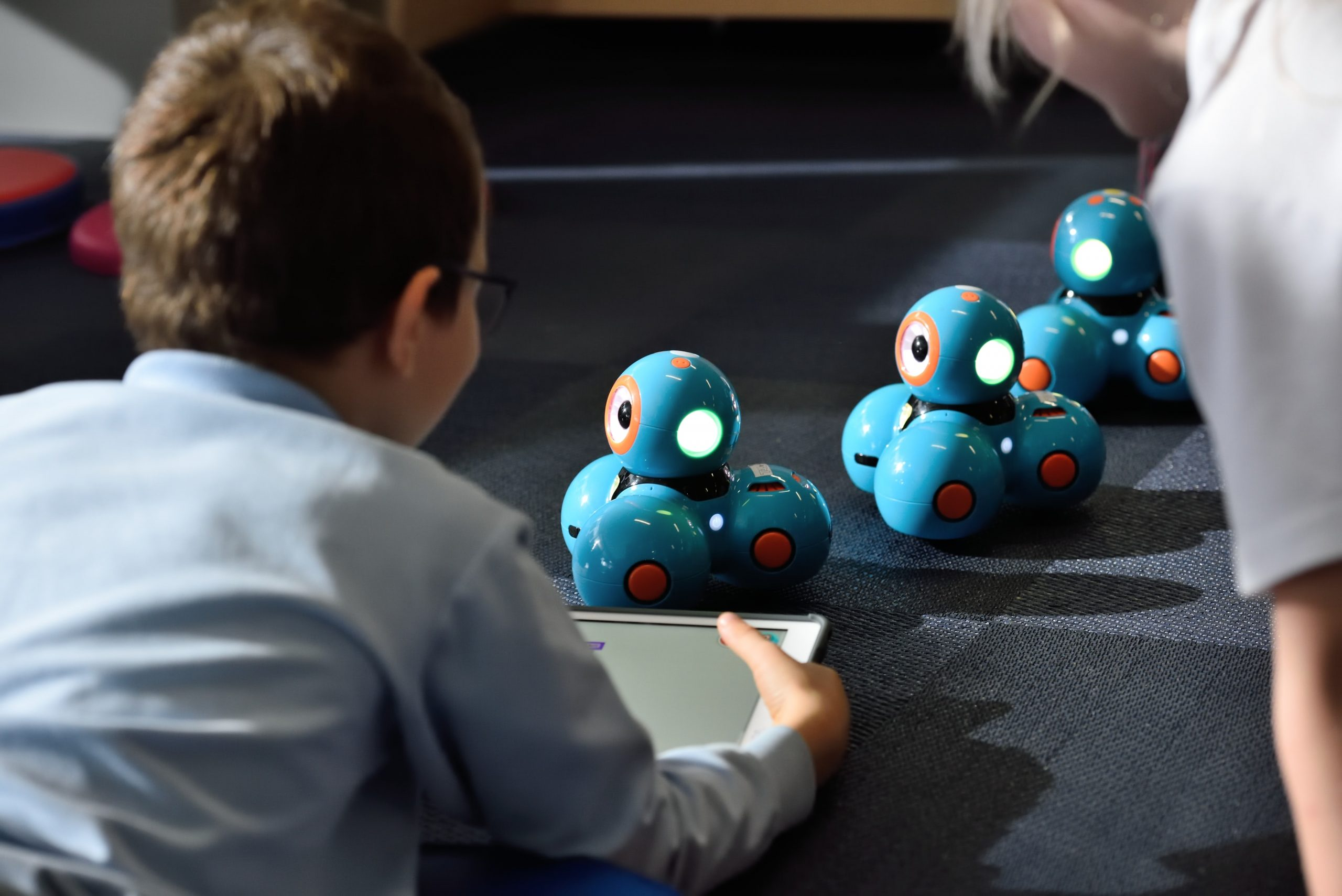 Kid playing with robots
